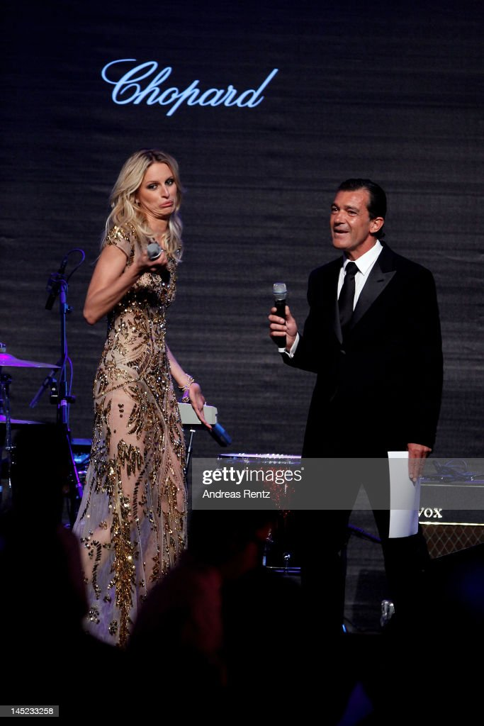 Actor Antonio Banderas and Karolina Kurkova appear during the 2012 amfAR's Cinema Against AIDS during the 65th Annual Cannes Film Festival at Hotel Du Cap on May 24, 2012 in Cap D'Antibes, France.