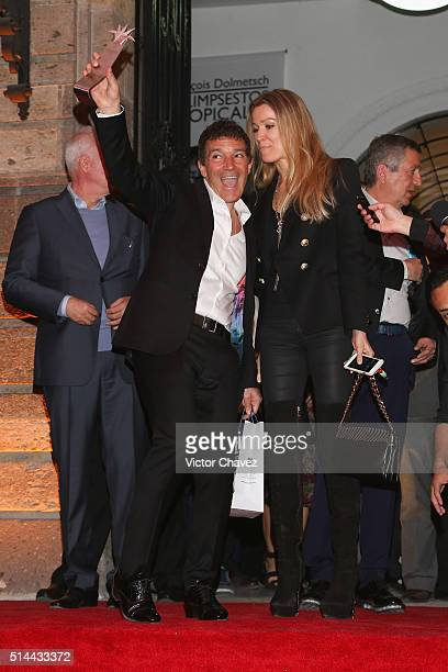 Actor Antonio Banderas holds the Mayahuel of Silver award for his carrer with his girlfriend Nicole Kimpel after a ceremony during the Festival...