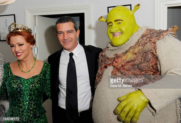 Actor Antonio Banderas poses with the cast members Kimberley Walsh and Nigel Lindsay of 'Shrek The Musical' at a photocall to promote his new film...