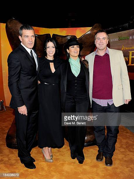 Actor Antonio Banderas producer Latifa Ouaou actress Salma Hayek and director Chris Miller arrive at the UK Premiere of 'Puss In Boots' at Empire...