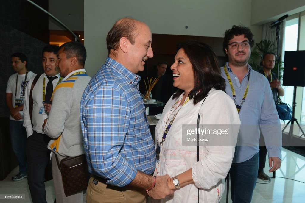 Actor <a gi-track='captionPersonalityLinkClicked' href=/galleries/search?phrase=Anupam+Kher&family=editorial&specificpeople=767439 ng-click='$event.stopPropagation()'>Anupam Kher</a> and filmmamker <a gi-track='captionPersonalityLinkClicked' href=/galleries/search?phrase=Mira+Nair&family=editorial&specificpeople=214181 ng-click='$event.stopPropagation()'>Mira Nair</a> attend at the Filmmakers Brunch during the 2012 Doha Tribeca Film Festival at Kempinski Sky Villa on November 19, 2012 in Doha, Qatar.
