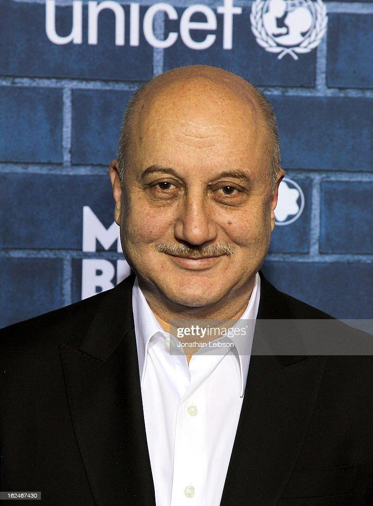 Actor <a gi-track='captionPersonalityLinkClicked' href=/galleries/search?phrase=Anupam+Kher&family=editorial&specificpeople=767439 ng-click='$event.stopPropagation()'>Anupam Kher</a> attends a Pre-Oscar charity brunch hosted by Montblanc and UNICEF to celebrate the launch of their new 'Signature For Good 2013' Initiative with special guest Hilary Swank at Hotel Bel-Air on February 23, 2013 in Los Angeles, California.