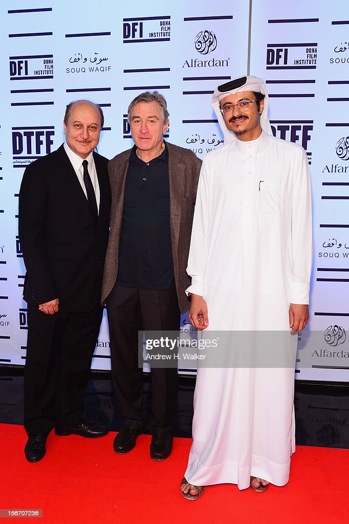 Actor <a gi-track='captionPersonalityLinkClicked' href=/galleries/search?phrase=Anupam+Kher&family=editorial&specificpeople=767439 ng-click='$event.stopPropagation()'>Anupam Kher</a>, Tribeca Film Festival co-founder <a gi-track='captionPersonalityLinkClicked' href=/galleries/search?phrase=Robert+De+Niro&family=editorial&specificpeople=201673 ng-click='$event.stopPropagation()'>Robert De Niro</a> and Doha Film Institute CEO Abdulaziz Bin Khalid Al-Khater attend the 'Silver Linings Playbook' premiere at the Al Mirqab Hotel during the 2012 Doha Tribeca Film Festival on November 19, 2012 in Doha, Qatar.
