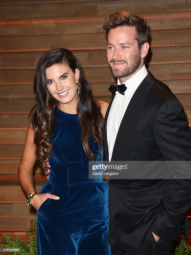 Actor <a gi-track='captionPersonalityLinkClicked' href=/galleries/search?phrase=Armie+Hammer&family=editorial&specificpeople=5313113 ng-click='$event.stopPropagation()'>Armie Hammer</a> (R) and actress wife <a gi-track='captionPersonalityLinkClicked' href=/galleries/search?phrase=Elizabeth+Chambers&family=editorial&specificpeople=5295153 ng-click='$event.stopPropagation()'>Elizabeth Chambers</a> attend the 2014 Vanity Fair Oscar Party hosted by Graydon Carter on March 2, 2014 in West Hollywood, California.
