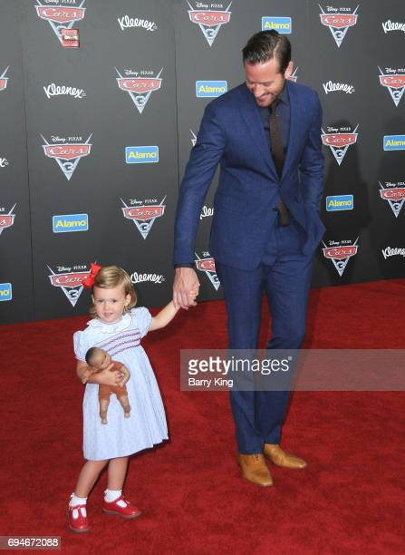 Actor Armie Hammer and daughter Harper Hammer attend the World Premiere of Disney and Pixar's 'Cars 3' at Anaheim Convention Center on June 10 2017...