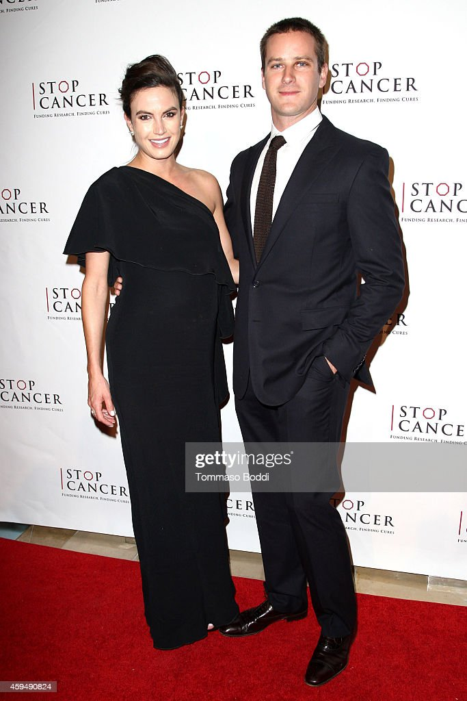 Actor <a gi-track='captionPersonalityLinkClicked' href=/galleries/search?phrase=Armie+Hammer&family=editorial&specificpeople=5313113 ng-click='$event.stopPropagation()'>Armie Hammer</a> (R) and model <a gi-track='captionPersonalityLinkClicked' href=/galleries/search?phrase=Elizabeth+Chambers&family=editorial&specificpeople=5295153 ng-click='$event.stopPropagation()'>Elizabeth Chambers</a> attend the STOP CANCER annual gala honoring Lori And Michael Milken held at The Beverly Hilton Hotel on November 23, 2014 in Beverly Hills, California.