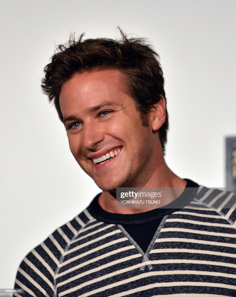 US actor Armie Hammer smiles upon his arrival at a press conference for his new film 'The Lone Ranger' in Tokyo on May 13, 2013. The movie, produced by Jerry Bruckheimer and co-starring Johnny Depp, will open in Japan on August 2. AFP PHOTO / Yoshikazu TSUNO