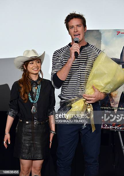 US actor Armie Hammer speaks after receiving a bouquet from Japanese actress Airi Taira at a press conference for his new film 'The Lone Ranger' in...