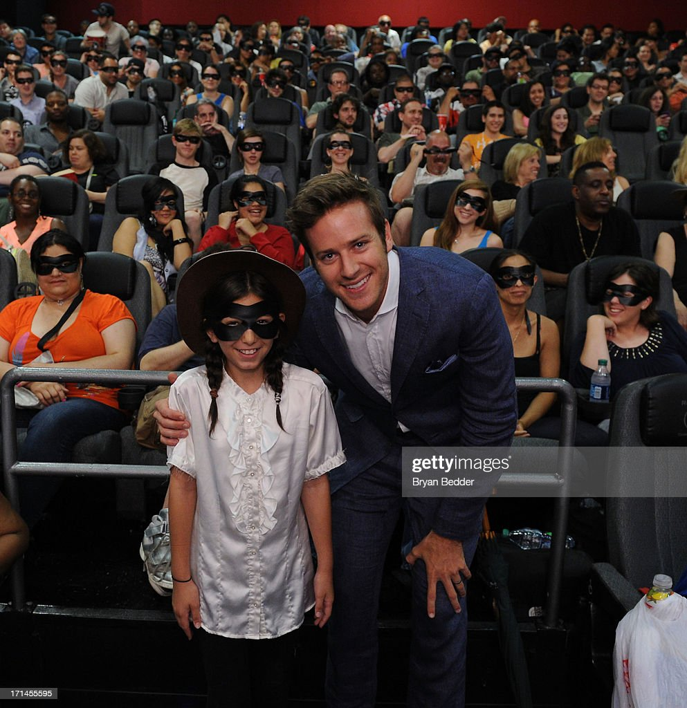 Actor Armie Hammer star of The Lone Ranger poses with Ava Ben Davin during a surprise appearance to honor outstanding local heroes as part of 'The Lone Ranger Ride For Justice' Screening Series on June 24, 2013 in New York City.