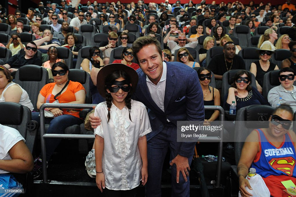 Actor <a gi-track='captionPersonalityLinkClicked' href=/galleries/search?phrase=Armie+Hammer&family=editorial&specificpeople=5313113 ng-click='$event.stopPropagation()'>Armie Hammer</a> star of The Lone Ranger poses with Ava Ben Davin during a surprise appearance to honor outstanding local heroes as part of 'The Lone Ranger Ride For Justice' Screening Series on June 24, 2013 in New York City.