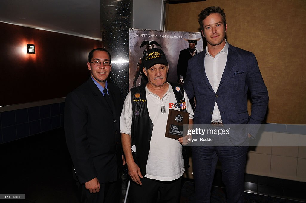 Actor <a gi-track='captionPersonalityLinkClicked' href=/galleries/search?phrase=Armie+Hammer&family=editorial&specificpeople=5313113 ng-click='$event.stopPropagation()'>Armie Hammer</a>, star of The Lone Ranger, right, poses with Brendon Hernadez, left, and Israel Hugo during a surprise appearance to honor outstanding local heroes as part of 'The Lone Ranger Ride For Justice' Screening Series on June 24, 2013 in New York City.