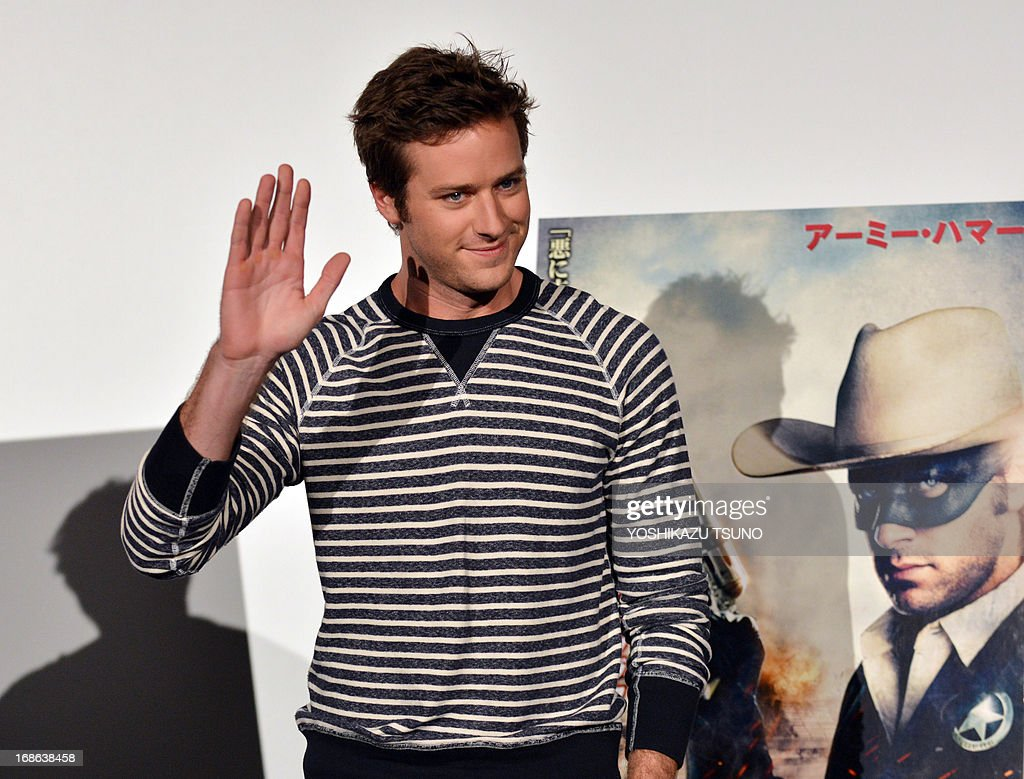 US actor Armie Hammer waves upon his arrival at a press conference for his new film 'The Lone Ranger' in Tokyo on May 13, 2013. The movie, produced by Jerry Bruckheimer and co-starring Johnny Depp, will open in Japan on August 2. AFP PHOTO / Yoshikazu TSUNO