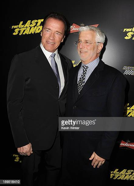 Actor Arnold Schwarzenegger and Rob Friedman Lionsgate Motion Picture Group CoChairman arrive at the premiere of Lionsgate Films' 'The Last Stand' at...