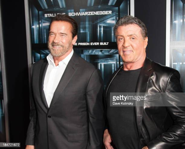 Actor Arnold Schwarzenegger and Sylvester Stallone attends 'Escape Plan' New York Premiere at Regal EWalk on October 15 2013 in New York City