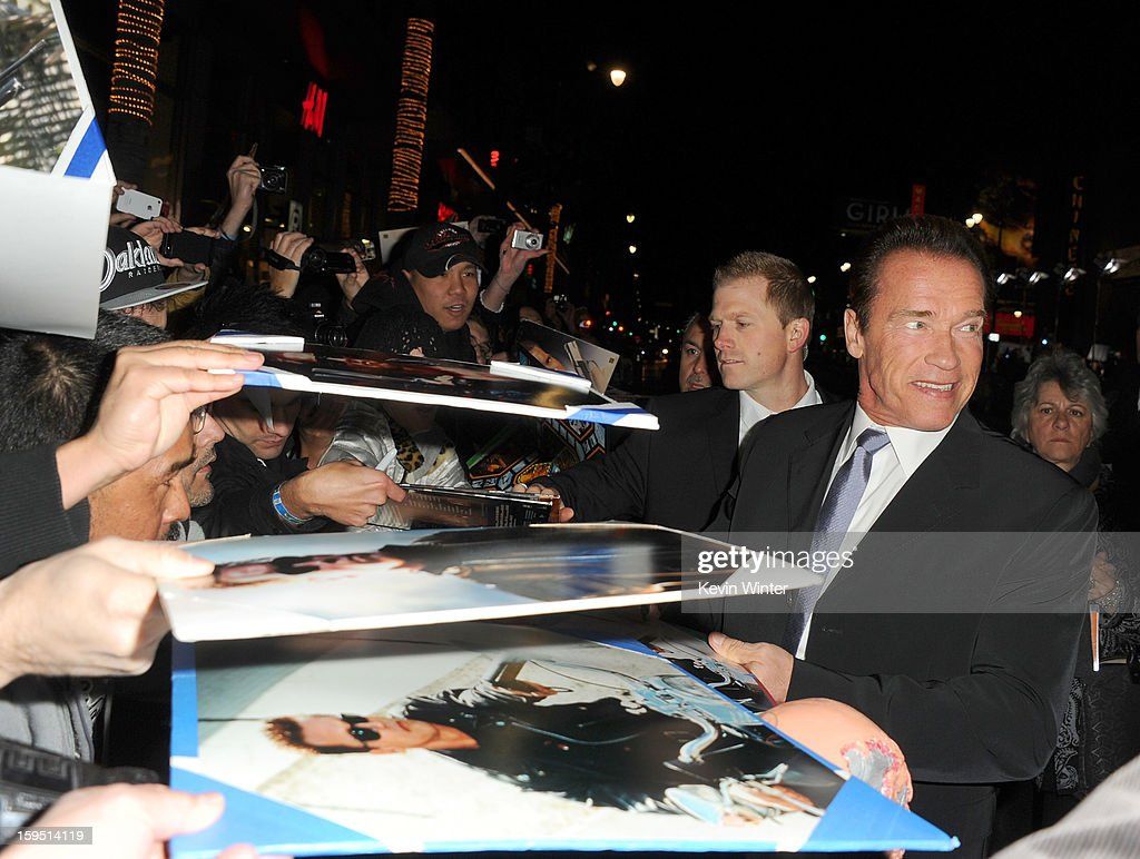 Actor Arnold Schwarzenegger (R) arrives at the premiere of Lionsgate Films' 'The Last Stand' at Grauman's Chinese Theatre on January 14, 2013 in Hollywood, California.