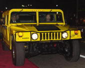 Actor Arnold Schwarzenegger arrives at the premiere of 'The Sixth Day' in his hummer November 13 2000 in Westwood CA