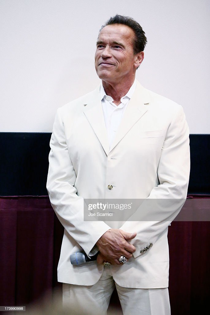 Actor Arnold Schwarzenegger attends the 'Escape Plan' screening and red carpet during Comic-Con International 2013 at Reading Cinemas Gaslamp on July 18, 2013 in San Diego, California.