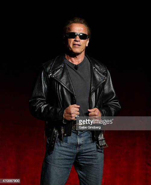 Actor Arnold Schwarzenegger dressed as the Terminator from the 'The Terminator' movie franchise speaks during The State of the Industry Past Present...