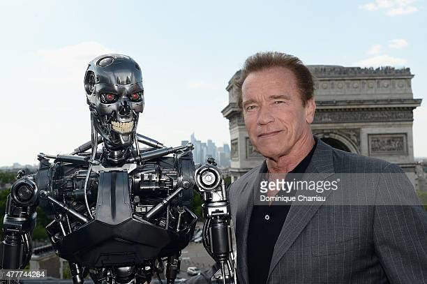 Actor Arnold Schwarzenegger poses with Endoskeleton during the France Photocall of 'Terminator Genisys' at the Publicis Champs Elysees on June 19...