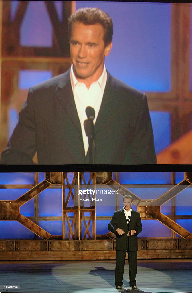 Actor <a gi-track='captionPersonalityLinkClicked' href=/galleries/search?phrase=Arnold+Schwarzenegger&family=editorial&specificpeople=156406 ng-click='$event.stopPropagation()'>Arnold Schwarzenegger</a> presents the Taurus Honorary Lifetime Achievement Award on stage during the 3rd Annual Taurus World Stunt Awards at Paramount Studios June 1, 2003 in Hollywood, California. The show will air Monday, June 9th, 8:00 pm EST/PST on the USA Network.