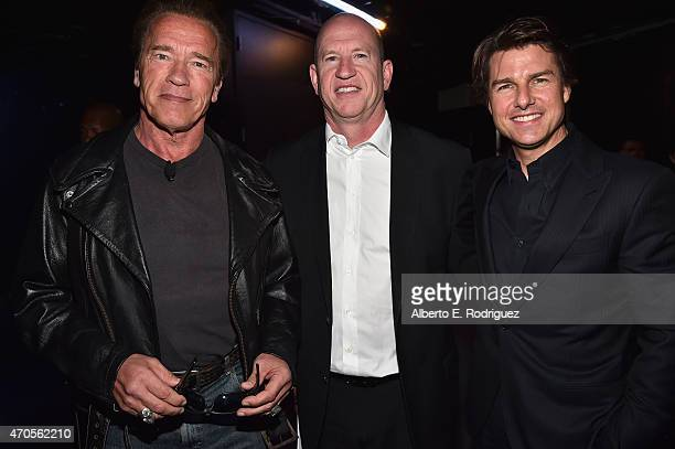 Actor Arnold Schwarzenegger Vice Chairman of Paramount Pictures Rob Moore and actor Tom Cruise attend The State of the Industry Past Present and...