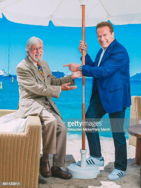 Actor Arnold Schwarzenegger with oceanographic explorer and environmental campaigner Jean Michel Cousteau are photographed for Paris Match on May 20...