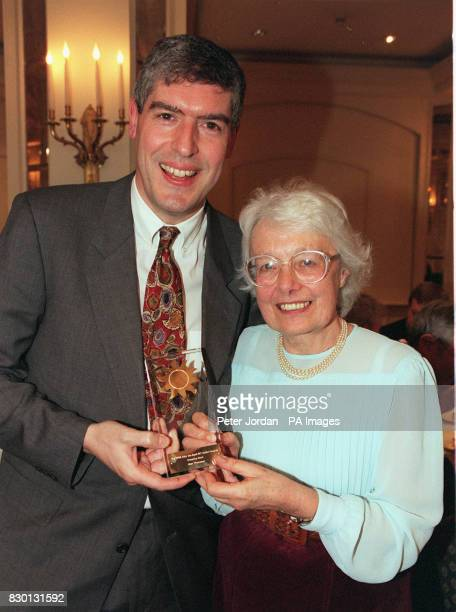 Actor Arthur Bostrom presents Jean Thompson with the Help The Aged NPI Creative Golden Award for establishing a unique international translation...