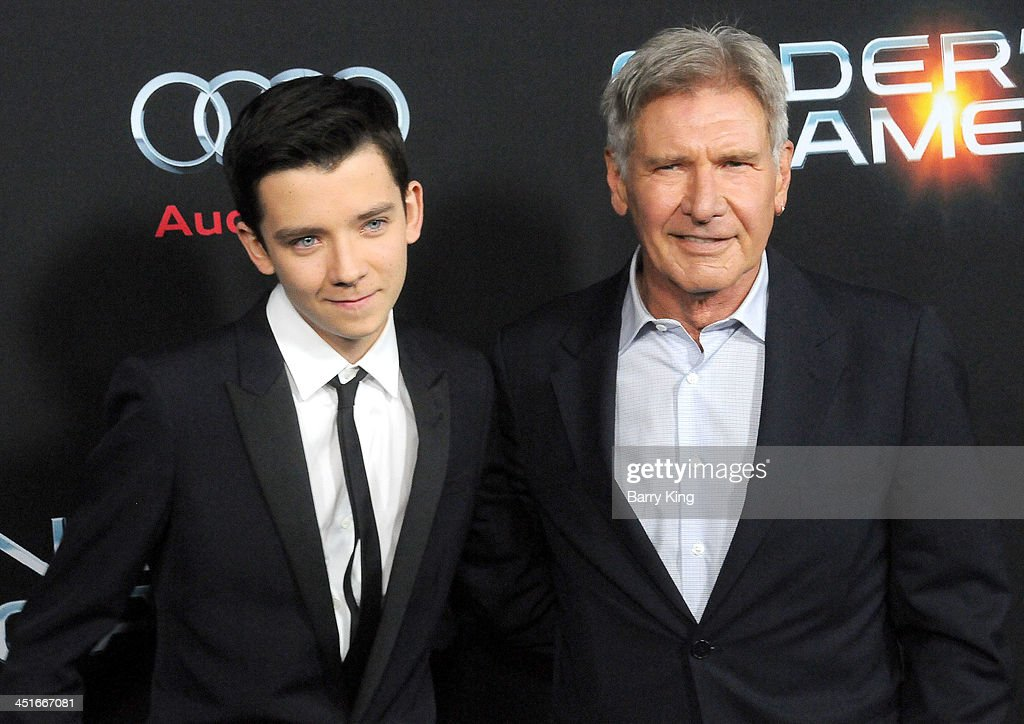 Actor Asa Butterfield a and actor Harrison Ford arrive at the Los Angeles Premiere 'Ender's Game' on October 28 2013 at TCL Chinese Theatre in...