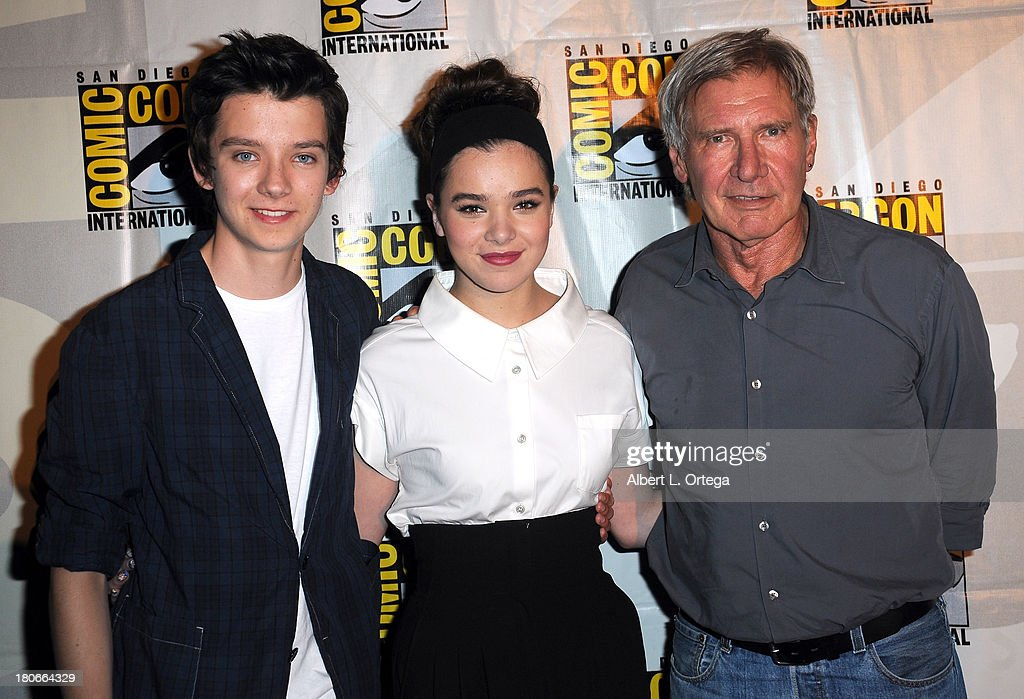 Actor <a gi-track='captionPersonalityLinkClicked' href=/galleries/search?phrase=Asa+Butterfield&family=editorial&specificpeople=5523693 ng-click='$event.stopPropagation()'>Asa Butterfield</a>, actress <a gi-track='captionPersonalityLinkClicked' href=/galleries/search?phrase=Hailee+Steinfeld&family=editorial&specificpeople=7223409 ng-click='$event.stopPropagation()'>Hailee Steinfeld</a> and actor <a gi-track='captionPersonalityLinkClicked' href=/galleries/search?phrase=Harrison+Ford+-+Actor+-+Born+1942&family=editorial&specificpeople=11508906 ng-click='$event.stopPropagation()'>Harrison Ford</a> participate in Summit Entertainment's 'Divergent' and 'Ender's Game' panels on Day 1 of the 2013 Comic-Con International held at San Diego Convention Center on Thursday July 18, 2012 in San Diego, California.