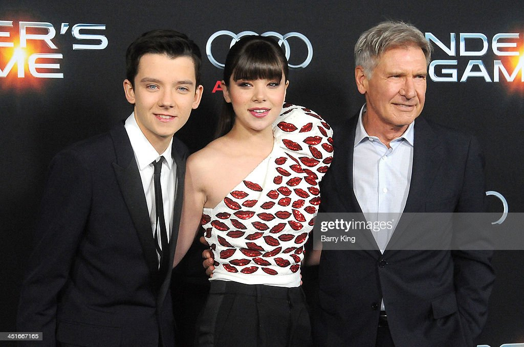 Actor Asa Butterfield, actress Hailee Steinfeld and actor Harrison Ford arrive at the Los Angeles Premiere 'Ender's Game' on October 28, 2013 at TCL Chinese Theatre in Hollywood, California.