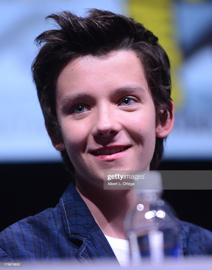 Actor <a gi-track='captionPersonalityLinkClicked' href=/galleries/search?phrase=Asa+Butterfield&family=editorial&specificpeople=5523693 ng-click='$event.stopPropagation()'>Asa Butterfield</a> speaks onstage at the 'Enders Game' and 'Divergent' panels during Comic-Con International 2013 at San Diego Convention Center on July 18, 2013 in San Diego, California.