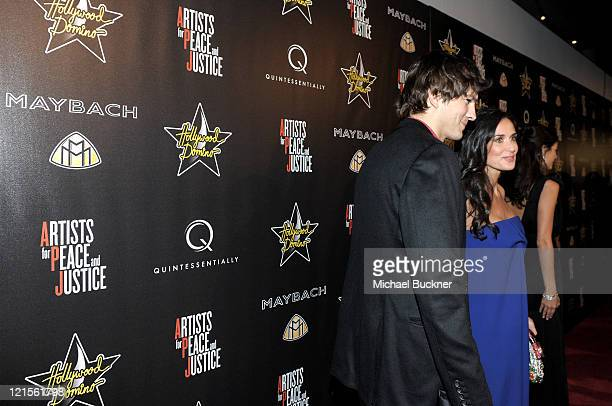 Actor Ashton Kutcher and actress Demi Moore arrive at the Maybach at the 3rd Annual PreOscar Hollywood Domino Gala Benefitting Artists for Peace and...