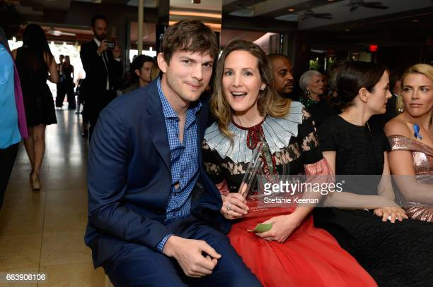 Actor Ashton Kutcher and honoree Samantha McMillen pose with the award for Men's Stylist of the Year during the Daily Front Row's 3rd Annual Fashion...