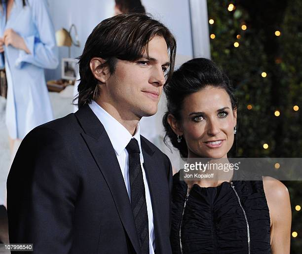 Actor Ashton Kutcher and wife actress Demi Moore arrive at the Los Angeles Premiere 'No Strings Attached' at Regency Village Theatre on January 11...