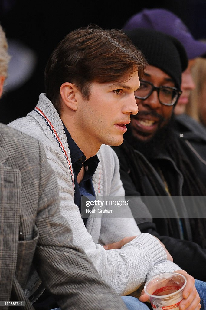 Actor Ashton Kutcher looks on during a game between the Minnesota Timberwolves and the Los Angeles Lakers at Staples Center on February 28, 2013 in Los Angeles, California.