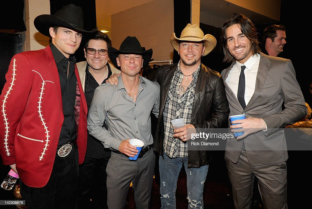 Actor Ashton Kutcher musicians Jay DeMarcus Kenny Chesney Jason Aldean and Jake Owen pose backstage at the 47th Annual Academy Of Country Music...
