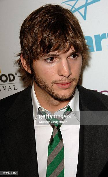 Actor Ashton Kutcher poses with the Ensemble award for 'Bobby' in the press room at The Hollywood Film Festival 10th Annual Hollywood Awards Gala...
