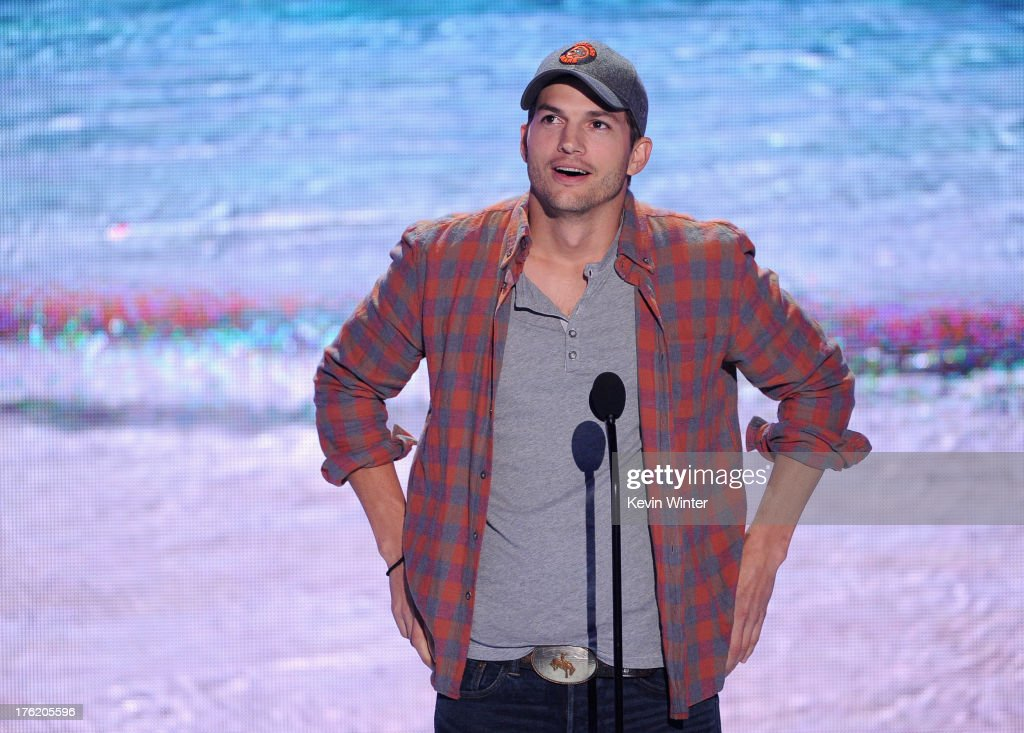 Actor Ashton Kutcher speaks onstage during the Teen Choice Awards 2013 at Gibson Amphitheatre on August 11, 2013 in Universal City, California.
