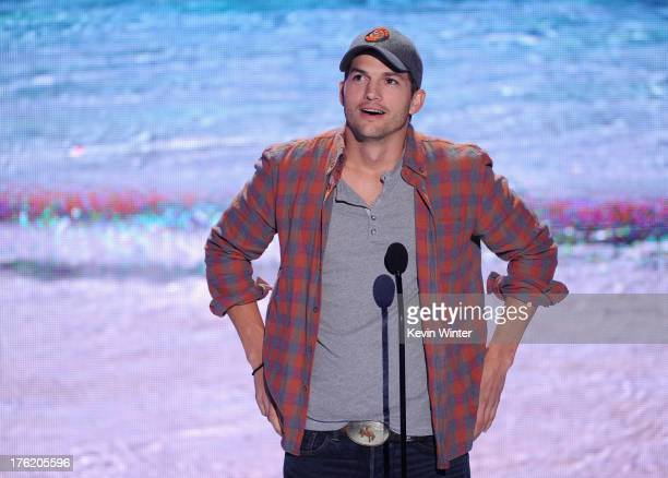 Actor Ashton Kutcher speaks onstage during the Teen Choice Awards 2013 at Gibson Amphitheatre on August 11 2013 in Universal City California