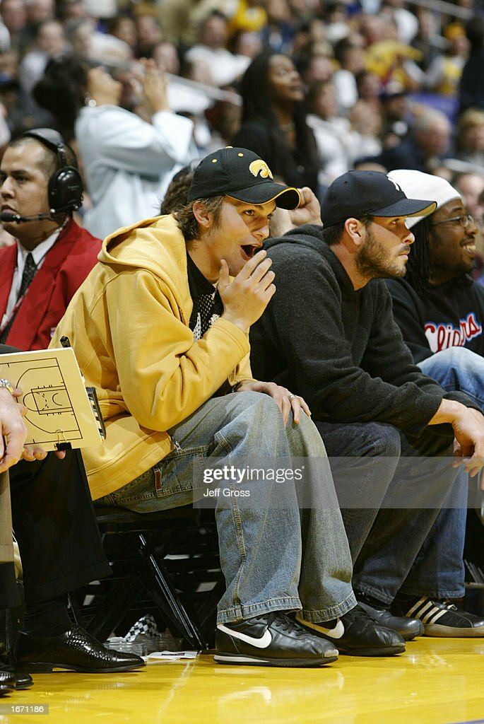 Actor Ashton Kutscher watches the Los Angeles Lakers take on the Memphis Grizzlies on December 3 2002 at Staples Center in Los Angeles California...