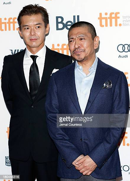 Actor Atsuro Watabe and director Hitoshi Matsumoto attend the premiere of 'R100' at Ryerson Theatre on September 12 2013 in Toronto Canada