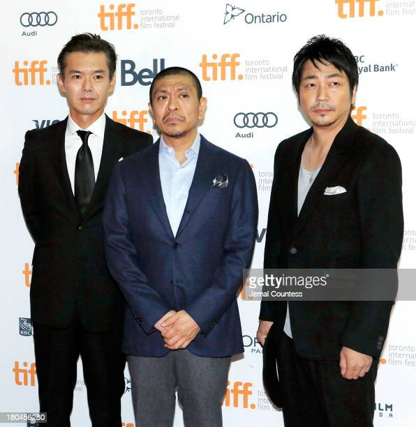 Actor Atsuro Watabe director Hitoshi Matsumoto and actor Nao Ohmori attemd the premiere of 'R100' at Ryerson Theatre on September 12 2013 in Toronto...