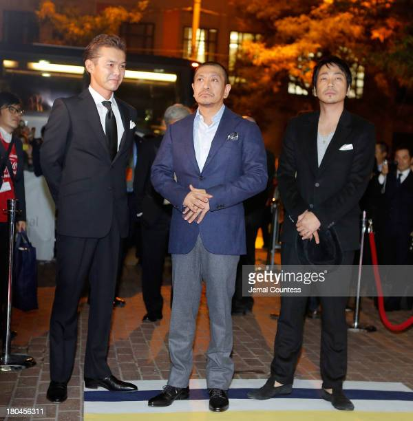 Actor Atsuro Watabe director Hitoshi Matsumoto and actor Nao Ohmori attend the premiere of 'R100' at Ryerson Theatre on September 12 2013 in Toronto...