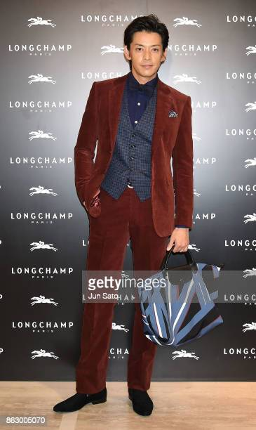 Actor Atsushi attends the opening ceremony of Longchamp La Maison Omotesando flagship store on October 19 2017 in Tokyo Japan