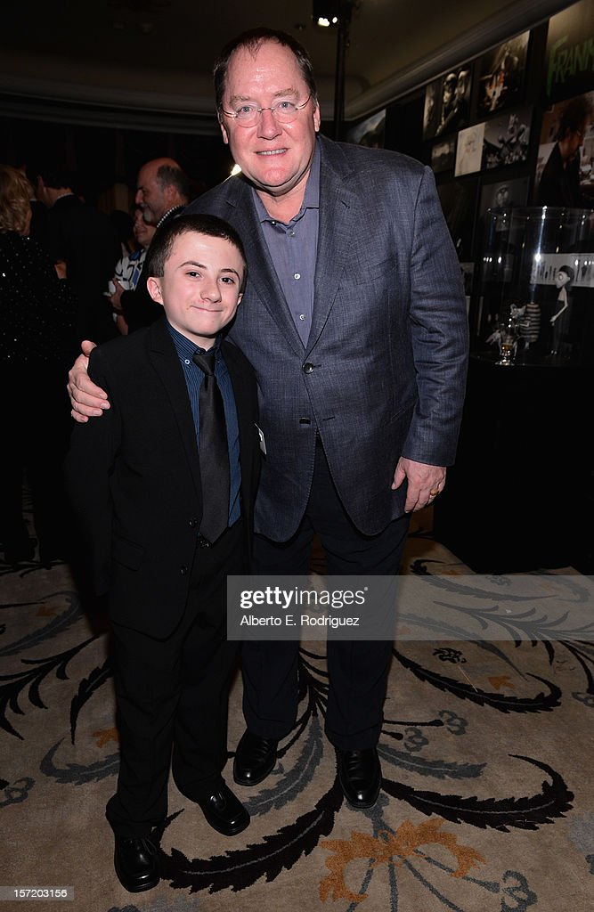 Actor Atticus Shaffer (L) and chief creative officer of Walt Disney and Pixar Animation Studios <a gi-track='captionPersonalityLinkClicked' href=/galleries/search?phrase=John+Lasseter&family=editorial&specificpeople=224003 ng-click='$event.stopPropagation()'>John Lasseter</a> (R) attend Walt Disney Studios 2012 animation celebration at The Beverly Hills Hotel on November 29, 2012 in Beverly Hills, California.
