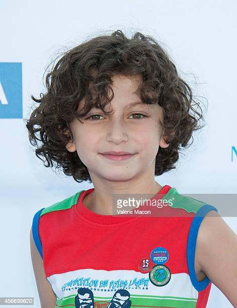 Actor August Maturo arrives at the 15th Annual Party On The Pier Hosted By Sarah Michelle Gellar at Santa Monica Pier on October 5 2014 in Santa...