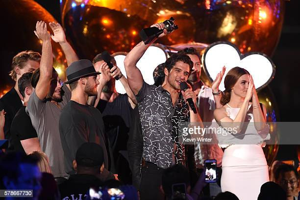 Actor Austin Butler presents the Fandom of the Year award to Executive producer Jeff Davis actors Cody Christian JR Bourne Dylan Sprayberry Host...