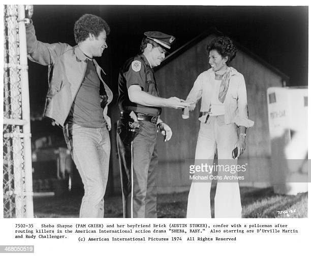 Actor Austin Stoker and actress Pam Grier on set of the movie ''Sheba Baby ' circa 1975