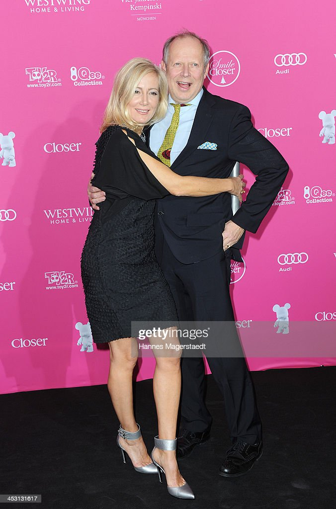 Actor <a gi-track='captionPersonalityLinkClicked' href=/galleries/search?phrase=Axel+Milberg&family=editorial&specificpeople=2094657 ng-click='$event.stopPropagation()'>Axel Milberg</a> and his wife Judith Milberg attend the Closer Charity Event SMILE at Hotel Vier Jahreszeiten on December 2, 2013 in Munich, Germany.