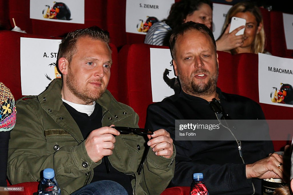 Actor Axel Stein and singer Smudo sit in the cinema to look 'Angry Birds' during the Berlin premiere of the film 'Angry Birds - Der Film' at CineStar on May 1, 2016 in Berlin, Germany.